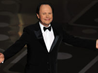 Comedian Billy Crystal arrives on stage at Oscars