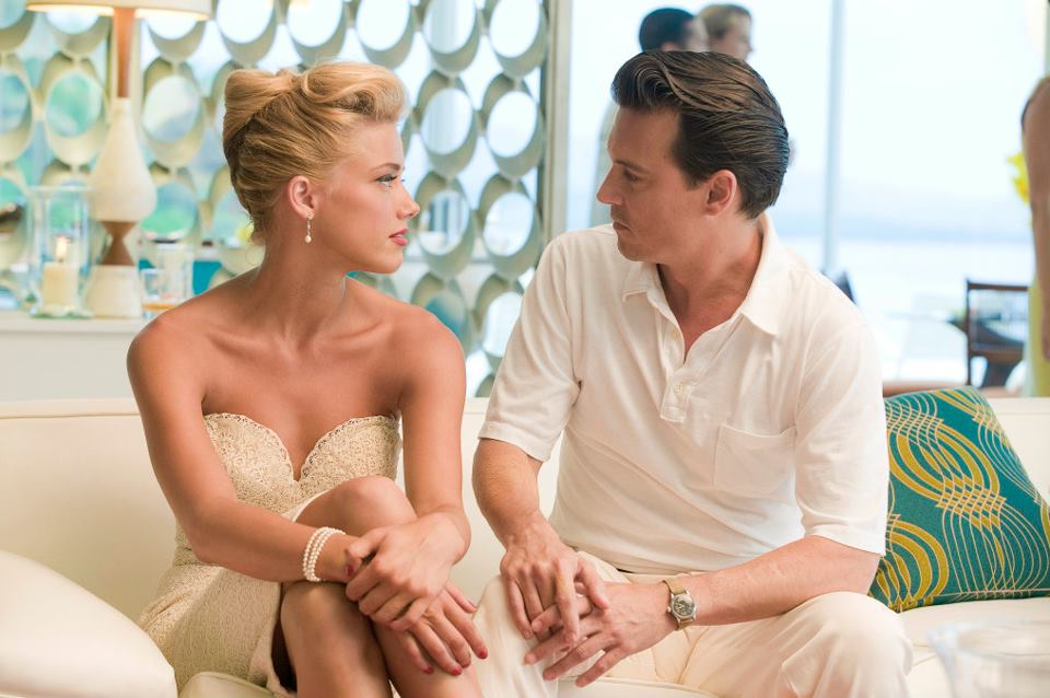 Chenault (Amber Heard) and Paul (Johnny Depp) - THE RUM DIARY