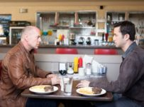 Looper - Bruce Willis and Joseph Gordon-Levitt in a diner